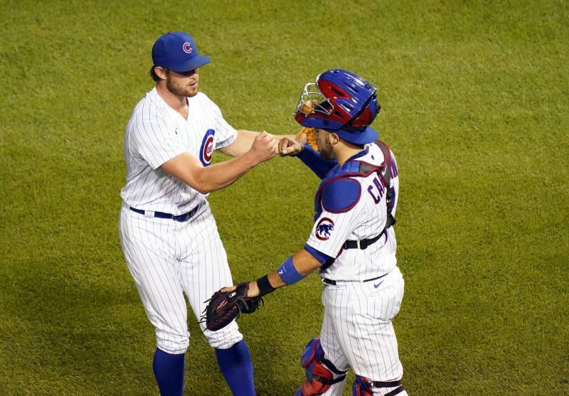 CHICAGO, ILLINOIS - AUGUST 13: Rowan Wick #50 of the Chicago Cubs and Victor Caratini #7 of the Chicago Cubs celebrate their team's 4-2 over the Milwaukee Brewers at Wrigley Field on August 13, 2020 in Chicago, Illinois. (Photo by Nuccio DiNuzzo/Getty Images)