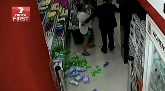 Ms Holmes wiped out a shelf of bottles in anger. Source: 7 News