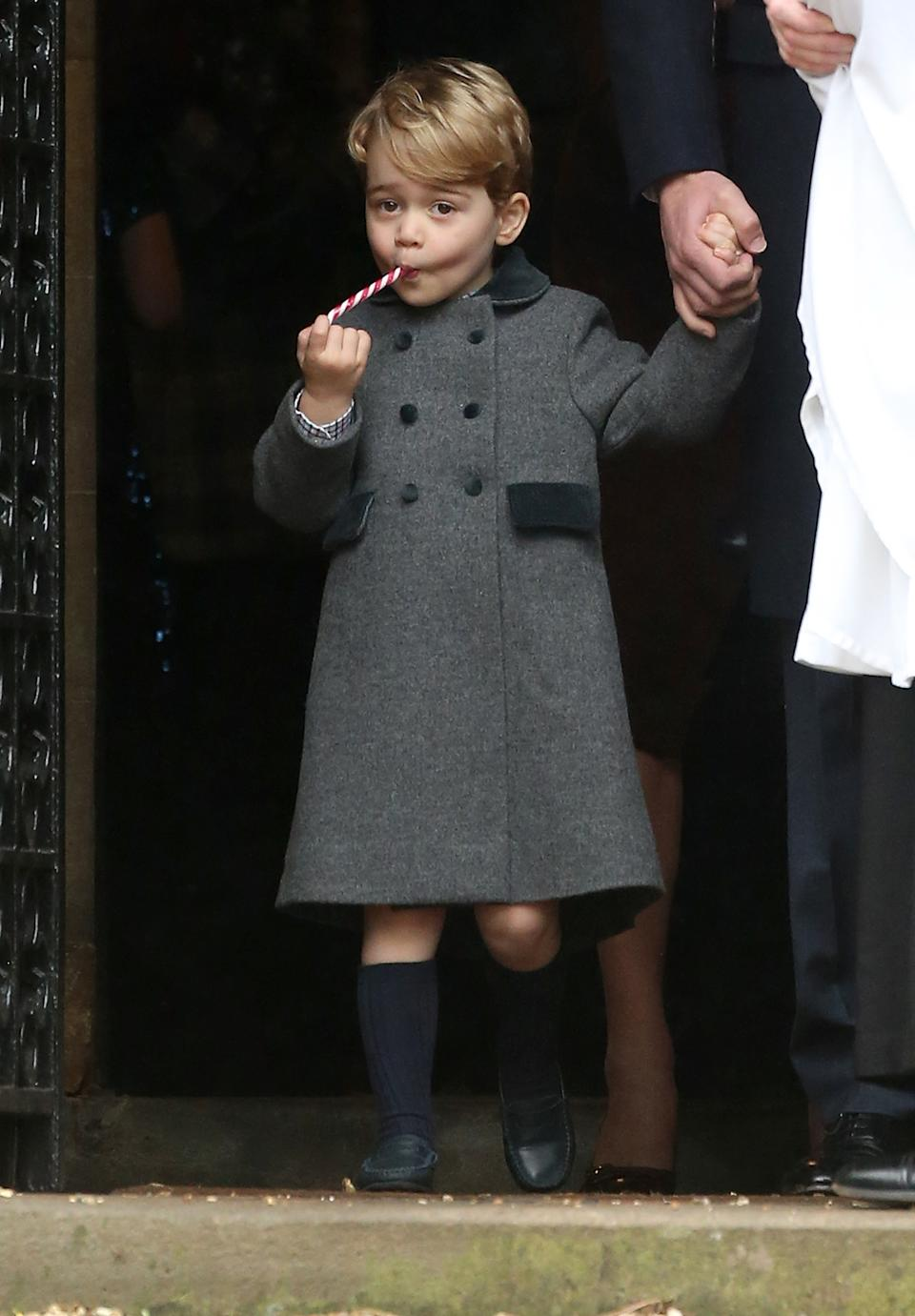 Despite the freezing temperatures on Christmas Day in 2016, Prince George was seen leaving church in shorts and long socks. Photo: Getty