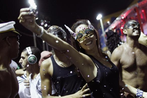 Revelers take part in a masquerade party during Carnival celebrations in Salvador February 17, 2012.