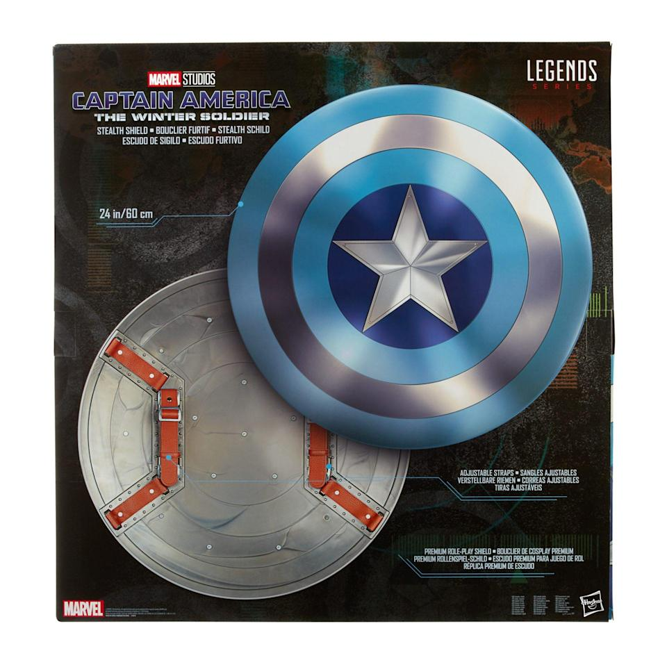 A blue and silver Captain America shield, with a view of the silver back which also has straps