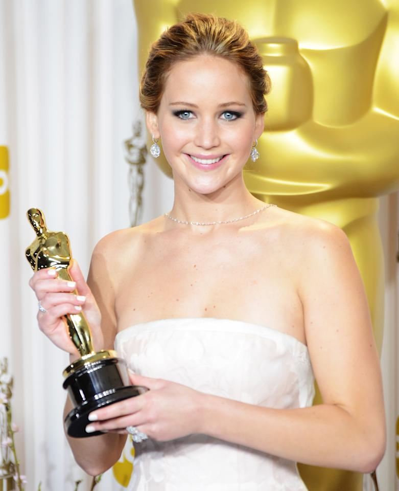 Jennifer Lawrence poses in the press room during the Oscars at Loews Hollywood Hotel on February 24, 2013 in Hollywood, California.