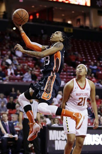 Miami guard Suriya McGuire (33) shoots over Maryland forward Tianna Hawkins (21) in the first half of an NCAA college basketball game in College Park, Md., Thursday, Jan. 10, 2013. (AP Photo/Patrick Semansky)