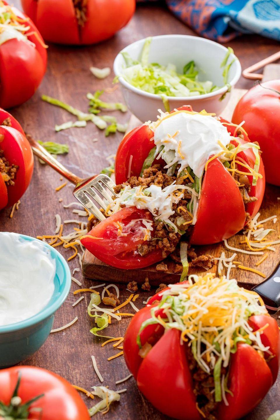 """<p>We're all for a genius low-carb hack — and these tomatoes totally deliver. We had never thought to stuff them with taco meat, cheese, and sour cream, but we'll do anything in the name of ditching a tortilla for a low-carb meal.</p><p>Get the <a href=""""https://www.delish.com/uk/cooking/recipes/a30053026/taco-tomatoes-recipe/"""" rel=""""nofollow noopener"""" target=""""_blank"""" data-ylk=""""slk:Taco Tomatoes"""" class=""""link rapid-noclick-resp"""">Taco Tomatoes</a> recipe.</p>"""