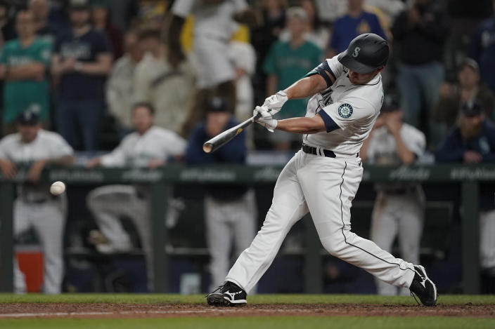 Seattle Mariners' Kyle Seager hits a single to drive in the winning run in the ninth inning of the team's baseball game against the Tampa Bay Rays, Thursday, June 17, 2021, in Seattle. The Mariners won 6-5. (AP Photo/Ted S. Warren)