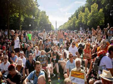 In Berlin, thousands take to streets against coronavirus restrictions; authorities warn of uptick in cases