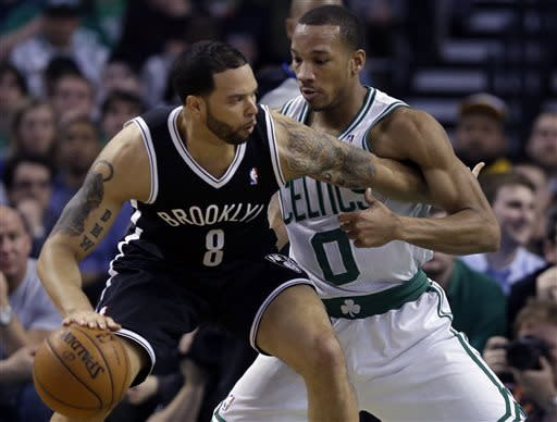 Brooklyn Nets point guard Deron Williams (8) tries to drive against Boston Celtics point guard Avery Bradley (0) during the second quarter of an NBA basketball game in Boston, Wednesday, April 10, 2013. (AP Photo/Elise Amendola)