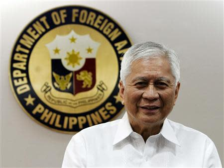 Philippine Foreign Affairs Secretary Albert Del Rosario poses for a picture before the start of a Reuters interview at the Department of Foreign Affairs headquarters in Manila September 4, 2013. REUTERS/Romeo Ranoco