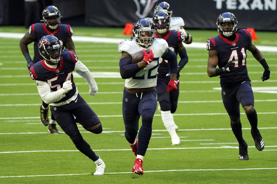 Tennessee Titans running back Derrick Henry (22) runs for a touchdown as Houston Texans' Jacob Martin (54) and Zach Cunningham (41) chase him. (AP Photo/Eric Christian Smith)