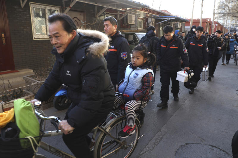 Hammer-wielding man attacks 20 children in Chinese primary school, officials say