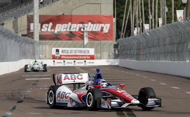 Takuma Sato, of Japan, heads for Turn 10 during practice for the IndyCar Series auto race Saturday, March 29, 2014, in St. Petersburg, Fla. Sato took the pole position during qualifying for Sunday's race. (AP Photo/Chris O'Meara)
