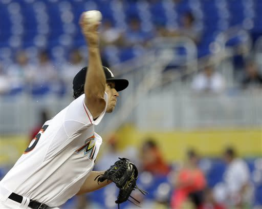 Miami Marlins' Kevin Slowey pitches to the Atlanta Braves in the first inning of a baseball game, Monday, July 8, 2013, in Miami. (AP Photo/Alan Diaz)