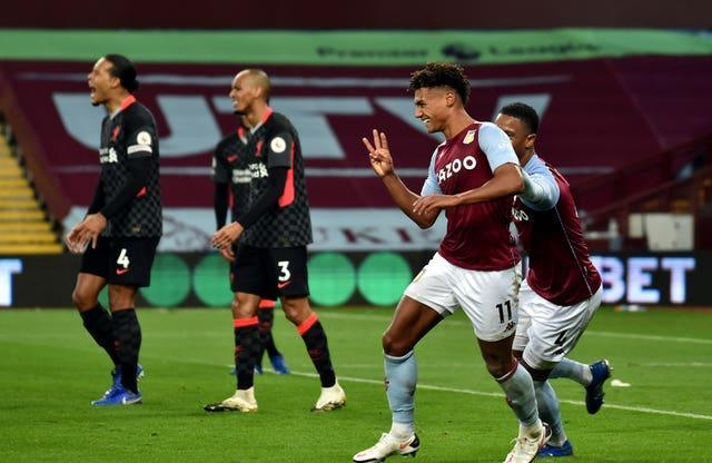 Ollie Watkins, second right, celebrates his hat-trick against Liverpool