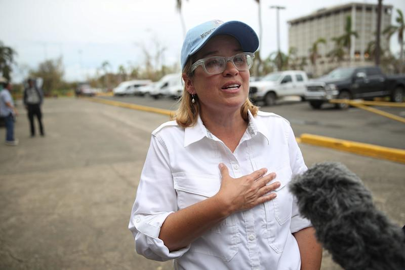 San Juan Mayor Carmen Yulín Cruz speaks to the media as she arrives at the temporary government center at Roberto Clemente Stadium on Sept. 30.