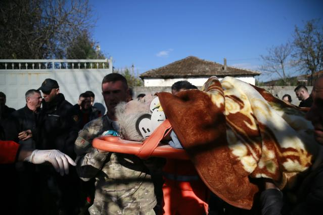 Rescuers carry an injured man after a magnitude 6.4 earthquake in Thumane. (Photo: Visar Kryeziu/AP)