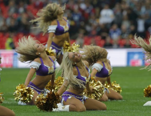 Minnesota Vikings cheerleaders perform before the Vikings met the Pittsburgh Steelers in their NFL football game at Wembley Stadium in London, September 29, 2013. REUTERS/Eddie Keogh (BRITAIN - Tags: SPORT FOOTBALL)
