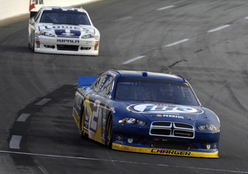 Brad Keselowski drives in front of Jimmie Johnson into Turn 3 during the NASCAR Sprint Cup Series auto race at Kentucky Speedway in Sparta, Ky., Saturday, June 30, 2012. Keselowski won the race. (AP Photo/James Crisp)