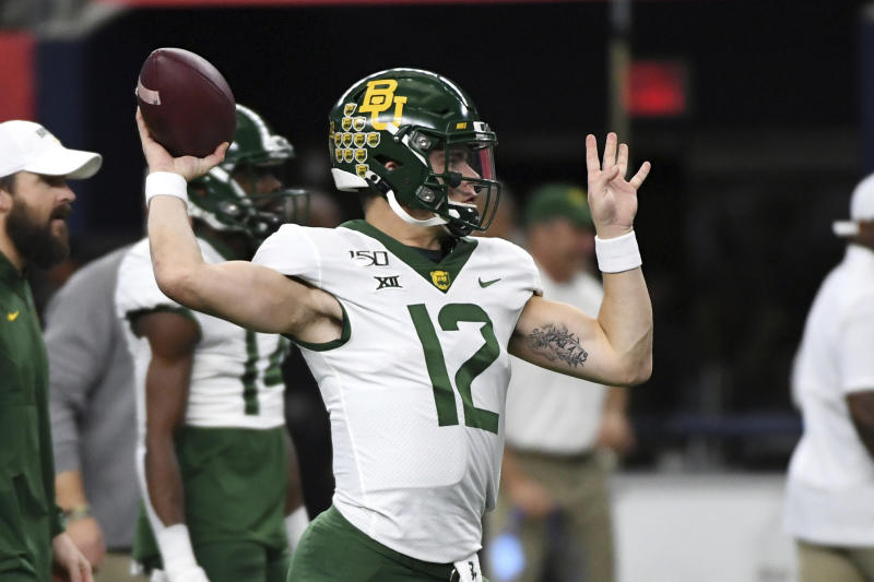 Baylor quarterback Charlie Brewer warms up before an NCAA college football game against OKlahoma at the Big 12 Conference championship, Saturday, Dec. 7, 2019, in Arlington, Texas. (AP Photo/Jeffrey McWhorter)