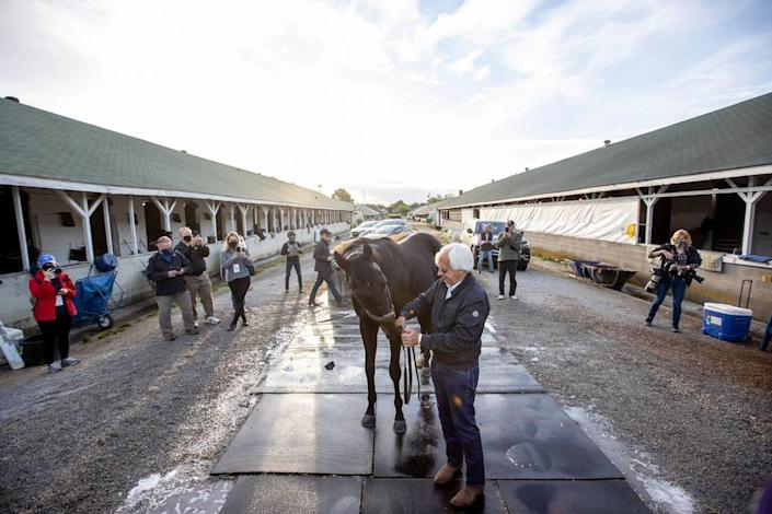 """Trainer Bob Baffert stood with Kentucky Derby winner Medina Spirit outside his barn on the backside at Churchill Downs in Louisville on Sunday. """"He wasn't as tired as I thought he might be. A big race like that, but he handled it quite well,"""" Baffert said."""