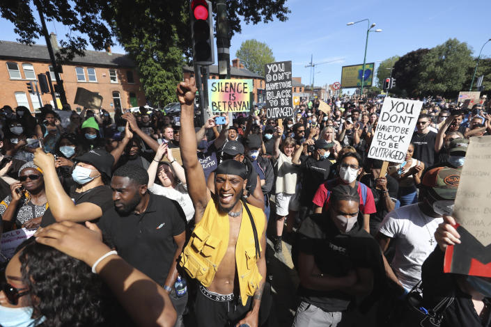 People protest under the slogan Black Lives Matter rally outside the US Embassy in Dublin, Ireland, Monday June 1, 2020, following the death of George Floyd in Minneapolis, USA. The recent killing of George Floyd in Minneapolis, USA, has led to protests in many countries, and across the U.S. (Niall Carson/PA via AP)
