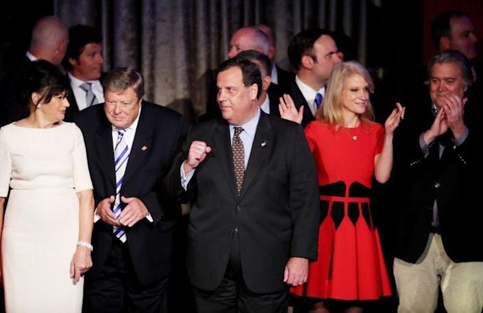 Christie stands on stage along with President-elect Trump's campaign manager, Kellyanne Conway and Trump campaign CEO Stephen Bannon. (Photo: Mark Wilson/Getty Images)