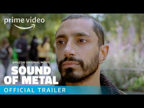 """<p>Roaring blast-beat assaults give way to eerie silence for Ruben (Riz Ahmed), a punk-metal drummer whose hearing disappears suddenly, and terrifyingly, in writer/director Darius Marder's <em>Sound of Metal</em>. Faced with this unexpected and debilitating turn of events, Ahmed's Ruben is forced by his bandmate/partner Lou (Olivia Cooke) to leave their tour and park his Airstream trailer at a home for the deaf run by generous but stern Joe (Paul Raci). Accepting fate, letting go of the past, and defining a new identity are all processes that require help from others, and thus prove deeply painful for Ruben, whose tattooed torso and bleach-blonde hair speak to his gung-ho go-it-alone spirit. Ruben is a recovering junkie whose quest to regain his auditory senses is its own form of addiction, and Ahmed embodies him with equal parts ferociousness and anguish. Marder evokes Ruben's condition through an expertly calibrated soundscape that vacillates between harmonious, crystal-clear atmospherics and the low, scary dullness that now besets Ruben. Sharply incorporating closed-captioning into its storytelling, it's a quiet-LOUD-quiet portrait of finding peace in the present stillness.</p><p><a class=""""link rapid-noclick-resp"""" href=""""https://www.amazon.com/Sound-Metal-Riz-Ahmed/dp/B08KZCFW1C?tag=syn-yahoo-20&ascsubtag=%5Bartid%7C10054.g.29500577%5Bsrc%7Cyahoo-us"""" rel=""""nofollow noopener"""" target=""""_blank"""" data-ylk=""""slk:Watch Now"""">Watch Now</a></p><p><a href=""""https://www.youtube.com/watch?v=VFOrGkAvjAE"""" rel=""""nofollow noopener"""" target=""""_blank"""" data-ylk=""""slk:See the original post on Youtube"""" class=""""link rapid-noclick-resp"""">See the original post on Youtube</a></p>"""