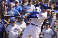 Chicago Cubs' Anthony Rizzo hits a home run off St. Louis Cardinals starting pitcher Daniel Ponce de Leon, on the 14th pitch of his at bat, during the sixth inning of a baseball game Friday, June 11, 2021, in Chicago. (AP Photo/Charles Rex Arbogast)