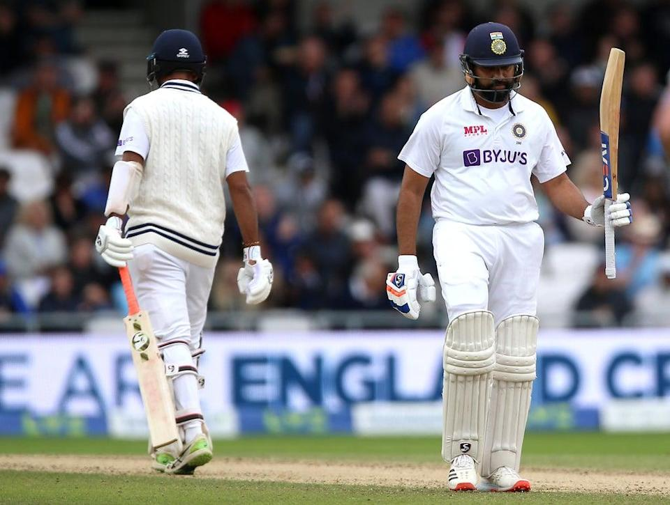 India's Rohit Sharma (right) celebrates reaching a half century during day three of the Third Test against England at Headingley (Nigel French/PA Images). (PA Wire)