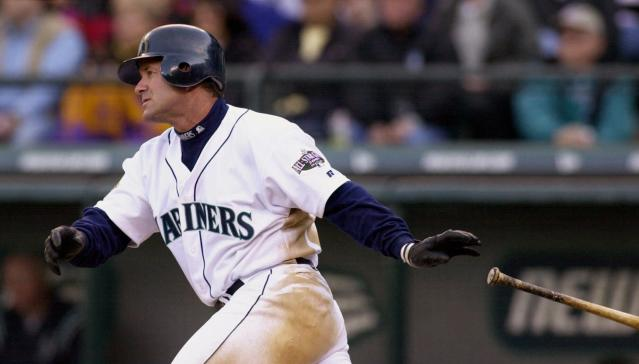 FILE - In this April 4, 2001, file photo, Seattle Mariners' Edgar Martinez drops his bat as he heads toward first on his sixth-inning, two-run double against the Oakland Athletics in Seattle. Martinez will go into the Baseball Hall of Fame on Sunday, the first player to spend his entire career with the Mariners--18 seasons in all--and find his way into Cooperstown. (AP Photo/Elaine Thompson, File)