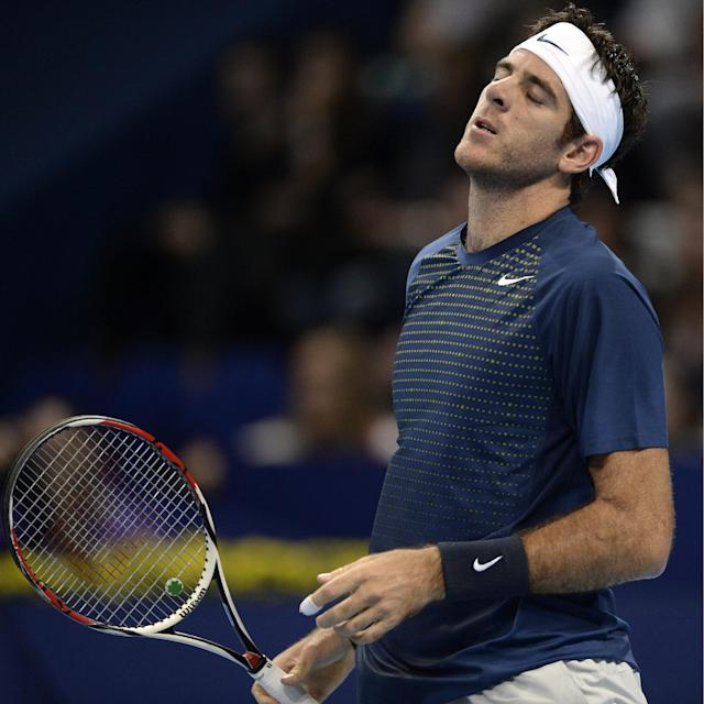 Argentina's Juan Martin Del Potro reacts during his semifinal match against France's Edouard Roger-Vasselin at the Swiss Indoors tennis tournament at the St. Jakobshalle in Basel, Switzerland, on Saturday, Oct. 26, 2013. (AP Photo/Keystone,Georgios Kefalas)