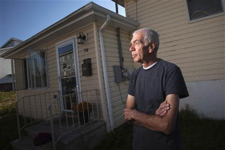 Frank Lettieri poses outside his home in the Staten Island borough of New York