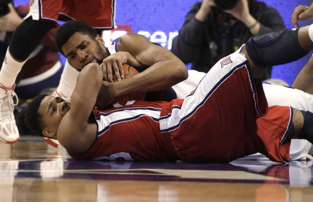 Saint Louis' Dwayne Evans, top, competes for a loose ball with Duquesne's Jeremiah Jones in the first half of an NCAA college basketball game, Thursday, Feb. 27, 2014, in St. Louis. (AP Photo/Tom Gannam)