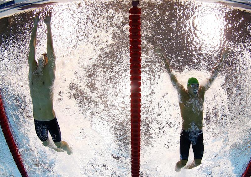 FILE - In this Aug. 3, 2012, file photo, Michael Phelps, of the United States, touches the wall ahead of Chad le Clos, of South Africa, for the win in the men's 100-meter butterfly final at the Aquatics Centre in the Olympic Park during the 2012 Summer Olympics in London. Phelps has added another triumph to his list of accomplishments: The Associated Press male athlete of the year, Thursday, Dec. 20, 2012. (AP Photo/Mark J. Terrill, File)
