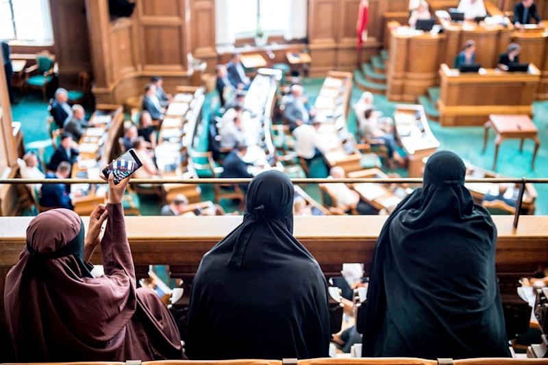Women wearing niqabs sit in thegallery at the Danish Parliament in Copenhagen on Thursday.
