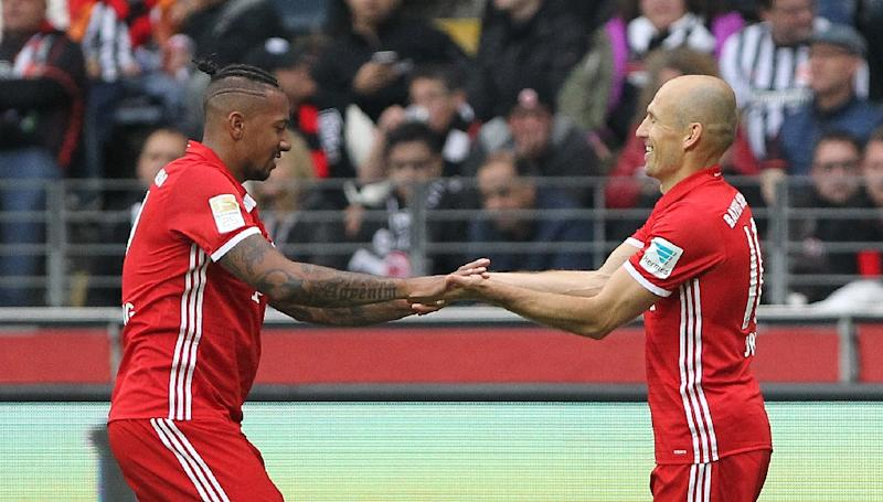 Arjen Robben (right) celebrates with Jerome Boateng after scoring for Bayern Munich against Eintracht Frankfurt in Frankfurt, on October 15, 2016 (AFP Photo/Daniel Roland)