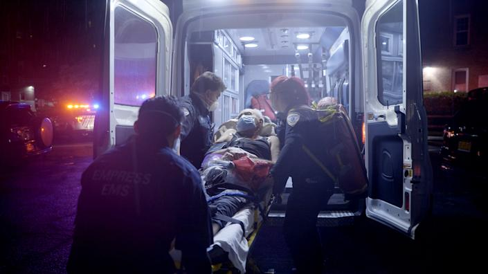 A patient is put in an ambulance by EMT's in Yonkers, N.Y., on April 30, 2020. (Ed Ou / NBC News)