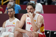Spain's Pau Gasol watches from the bench during a men's basketball preliminary round game against Slovenia at the 2020 Summer Olympics, Sunday, Aug. 1, 2021, in Saitama, Japan. (AP Photo/Charlie Neibergall)