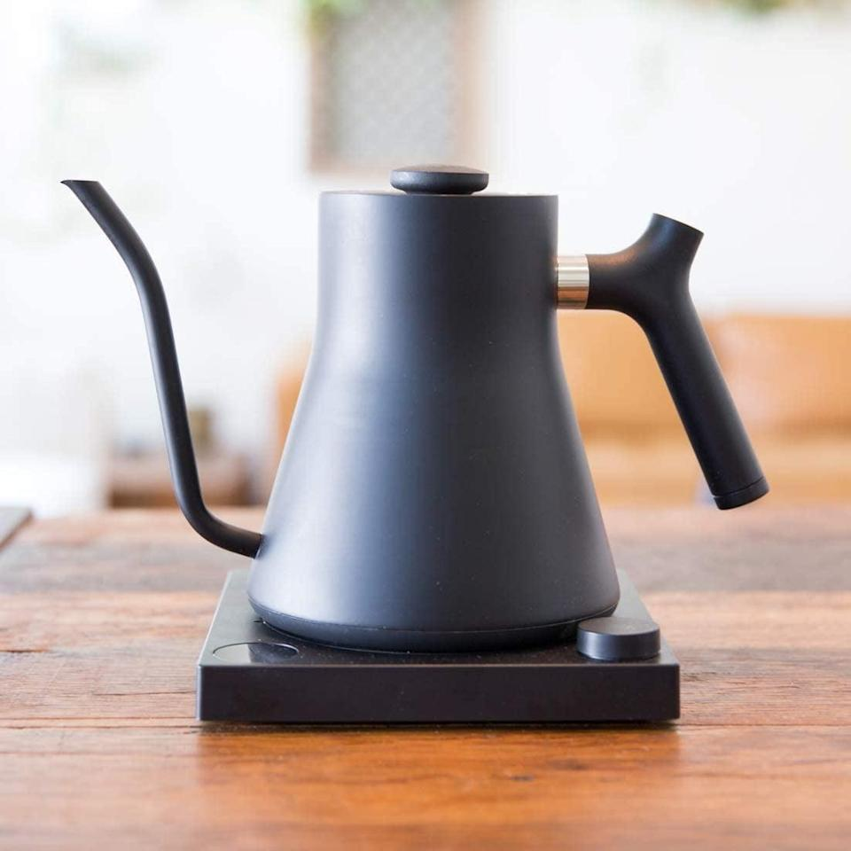 <p>This stylish <span>Fellow Stagg EKG Electric Pour-Over Kettle</span> ($149) heats up water fast and will look great on their countertop.</p>