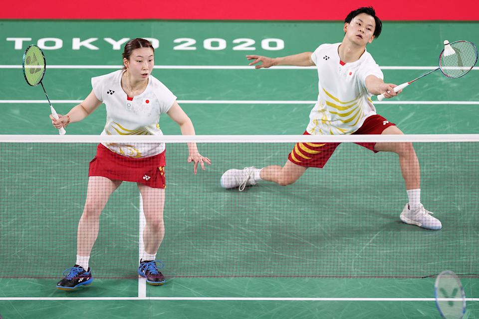 CHOFU, JAPAN - JULY 26: Yuta Watanabe(right) and Arisa Higashino of Team Japan compete against Praveen Jordan and Melati Daeva Oktavianti of Team Indonesia during a Mixed Doubles Group C match on day three of the Tokyo 2020 Olympic Games at Musashino Forest Sport Plaza on July 26, 2021 in Chofu, Tokyo, Japan. (Photo by Lintao Zhang/Getty Images)