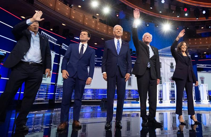 Entrepreneur Andrew Yang, Mayor of South Bend, Ind., Pete Buttigieg, Former Vice President Joe Biden, Vermont Sen. Bernie Sanders and California Sen. Kamala Harris arrive on stage for the second night of the first Democratic primary debate on June 27, 2019. | JIM WATSON—AFP/Getty Images