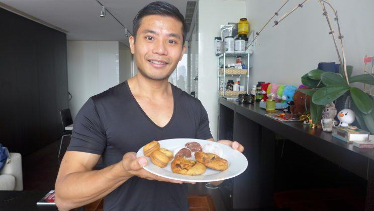 Fitness Instagrammer and baker Wyatt Tan carrying a plate of protein-rich desserts in his living room. (Yahoo Lifestyle Singapore)