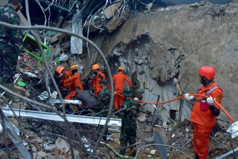Dozens of bodies have been hauled from beneath crumpled buildings in Mamuju, a city of about 110,000 in West Sulawesi province, while others were killed south of the area after the quake struck