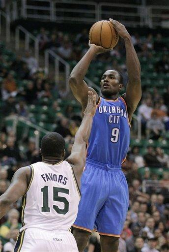 Oklahoma City Thunder center Serge Ibaka (9) shoots as Utah Jazz forward Derrick Favors (15) defends in the first quarter of a preseason NBA basketball game Friday, Oct. 12, 2012, in Salt Lake City. (AP Photo/Rick Bowmer)