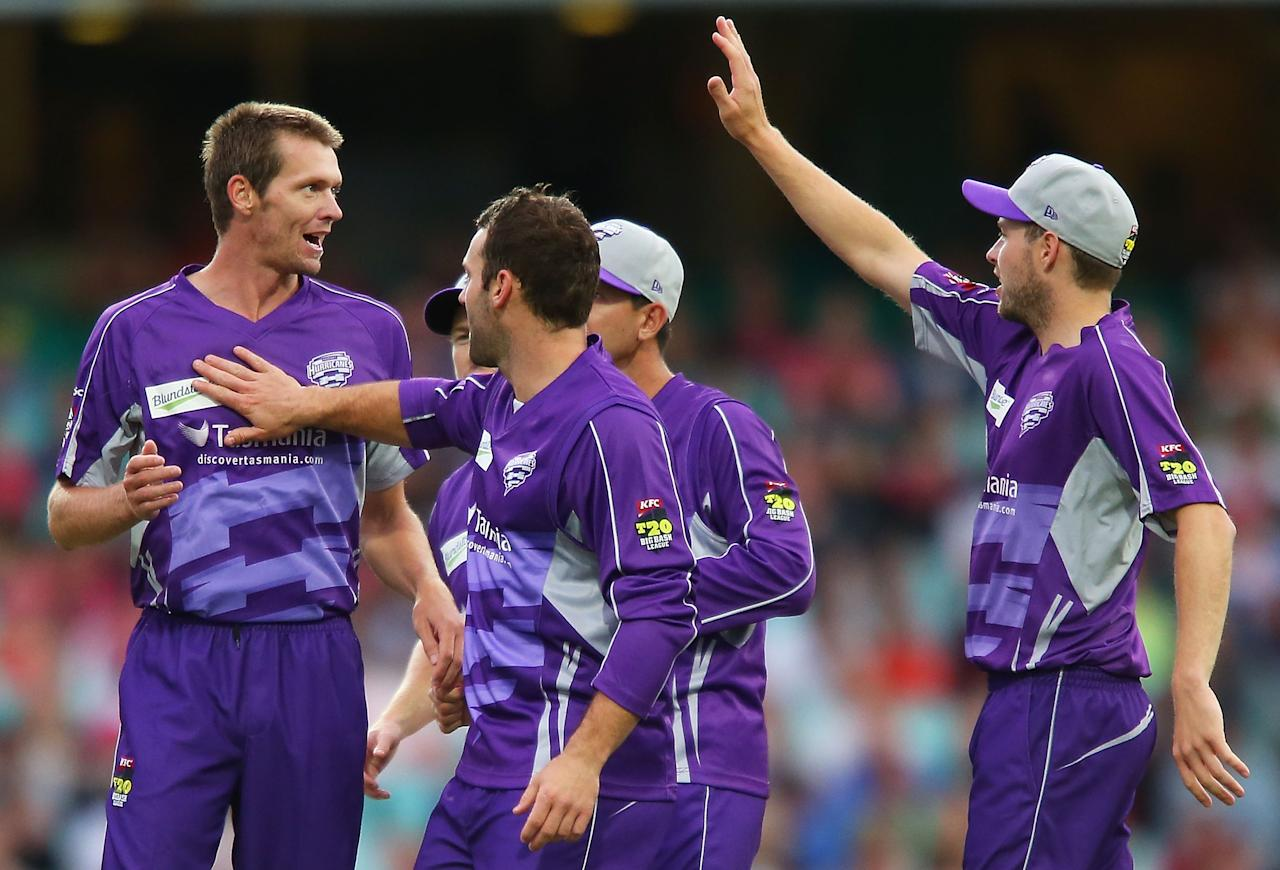 SYDNEY, AUSTRALIA - DECEMBER 26:  Michael Hogan of the Hurricanes celebrates with team mates after claiming the wicket of Brad Haddin of the Sixers during the Big Bash League match between the Sydney Sixers and the Hobart Hurricanes at SCG on December 26, 2012 in Sydney, Australia.  (Photo by Brendon Thorne/Getty Images)
