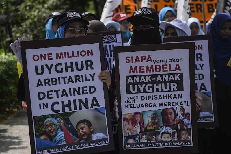 Hizbut Tahrir protesters carry placards during a protest held in solidarity with the Uighur community in China, December 27, 2019. ― Picture by Miera Zulyana