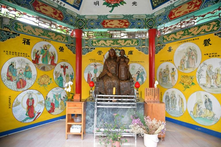 Statues of saints displayed in a Chinese-style pavilion in the Holy Spirit Church