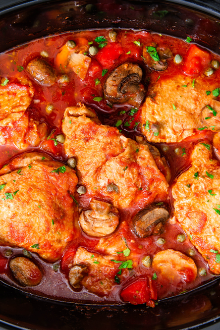 """<p>We love slow cookers because they do all of the work for us, meaning we can do literally anything else while the chicken cooks. Need dinner faster? Make our <a href=""""https://www.delish.com/uk/cooking/recipes/a30014156/easy-chicken-cacciatore-recipe/"""" rel=""""nofollow noopener"""" target=""""_blank"""" data-ylk=""""slk:classic chicken cacciatore"""" class=""""link rapid-noclick-resp"""">classic chicken cacciatore</a> instead.</p><p>Get the <a href=""""https://www.delish.com/uk/cooking/recipes/a30208240/slow-cooker-chicken-cacciatore-recipe/"""" rel=""""nofollow noopener"""" target=""""_blank"""" data-ylk=""""slk:Slow Cooker Chicken Cacciatore"""" class=""""link rapid-noclick-resp"""">Slow Cooker Chicken Cacciatore</a> recipe.</p>"""