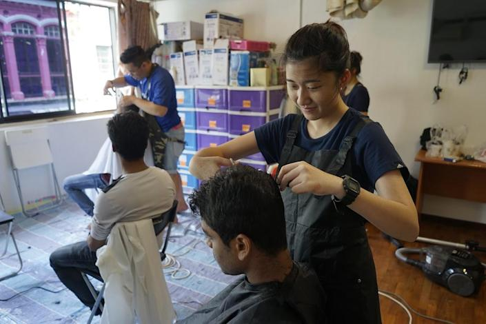 Volunteer coordinator and barber Sarah Ong at Transient Workers Count Too on 19 August, 2017. (PHOTO: Geylang Adventures)