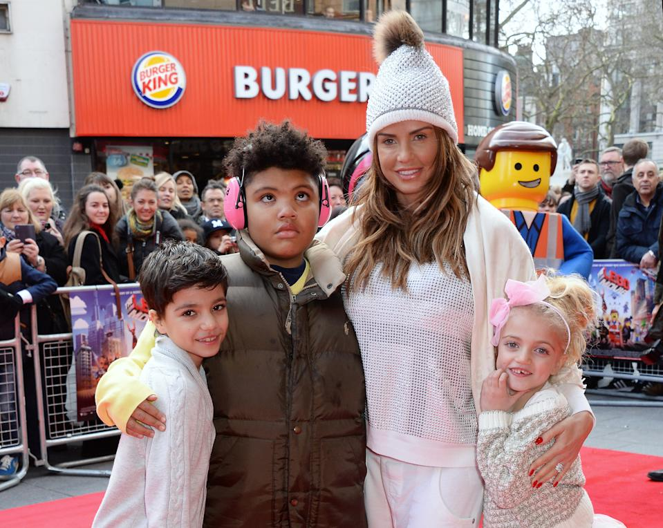 """LONDON, ENGLAND - FEBRUARY 09:  (EMBARGOED FOR PUBLICATION IN UK TABLOID NEWSPAPERS UNTIL 48 HOURS AFTER CREATE DATE AND TIME. MANDATORY CREDIT PHOTO BY DAVE M. BENETT/WIREIMAGE REQUIRED)  (L to R) Junior Andre, Harvey Price, Katie Price and Princess Andre attend a VIP screening of """"The Lego Movie"""" at the Vue West End on February 9, 2014 in London, England.  (Photo by Dave M. Benett/WireImage)"""