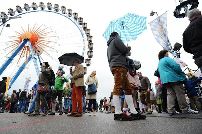 Visitors walk at the venue of the the annual Oktoberfest beer festival on October 04, 2015 in Muenchen (AFP Photo/Andreas Gebert)